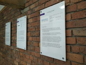 Case study displays on a wall